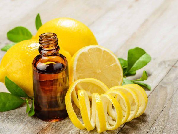 lemon essential oil and lemon fruit on the wooden board, (taken with tilt shift lens)